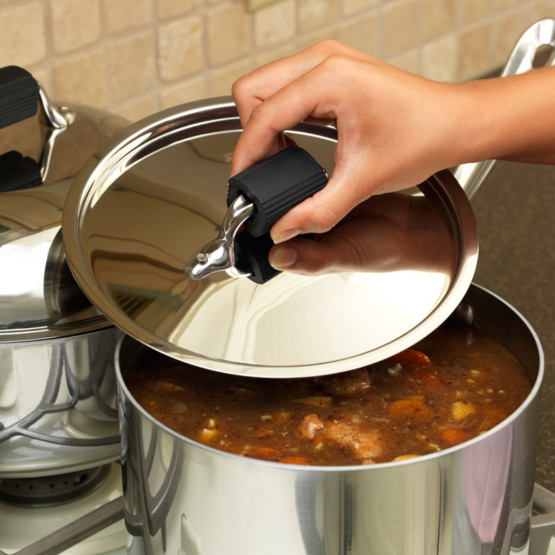 Pot lid being used with Cool Touch™ Pot Lid Handle Cover