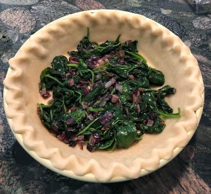 spinach onion mixture in Pie crust